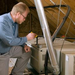 A East Aurora attic air conditioner system being serviced